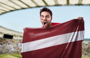 Fan holding the flag of Latvia